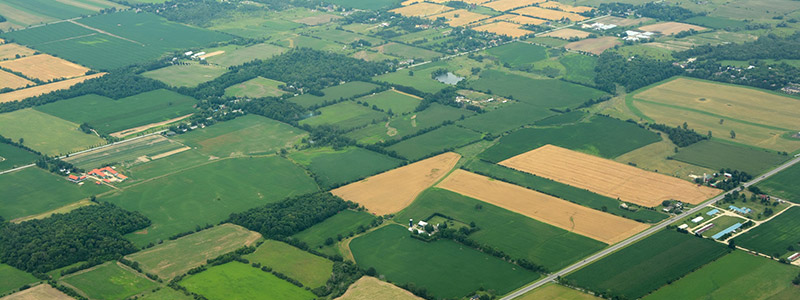 Aerial view of a agricultural landscape, fields, farms, houses